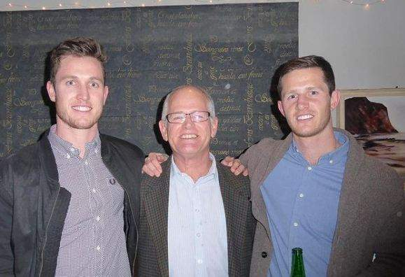 Adam Milne with his father and brother