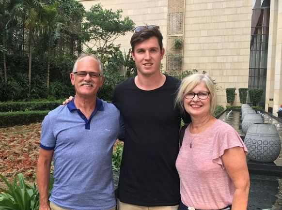 Adam Milne with his parents