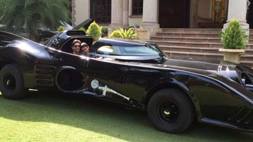 Adar Poonawalla with his son in the Batmobile