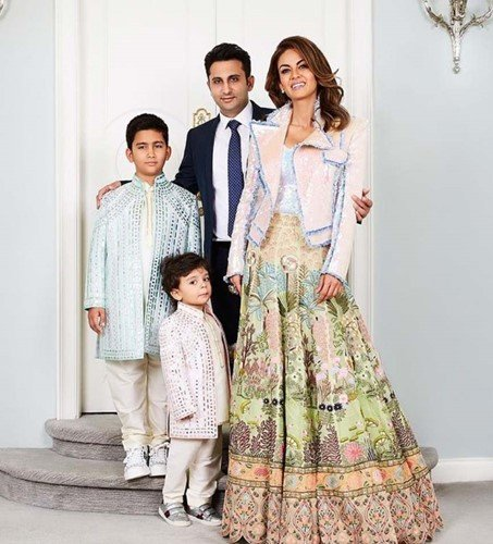 Adar Poonawalla with his wife, Natasha, and his sons, Cyrus (left) and Darius (front)