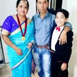 Akash Thapa with his parents
