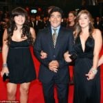 Diego Maradona with his two daughters (Giannina on the left and Dalman on the right)