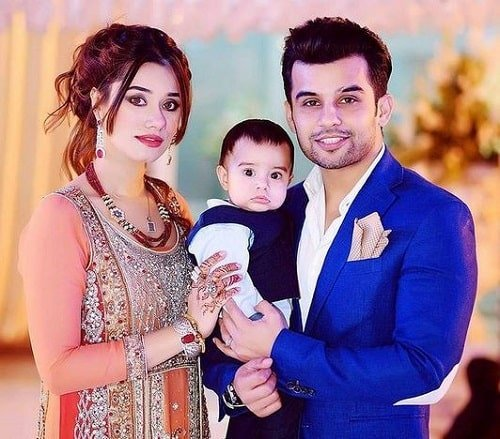 Fahad Shaikh with his wife and son
