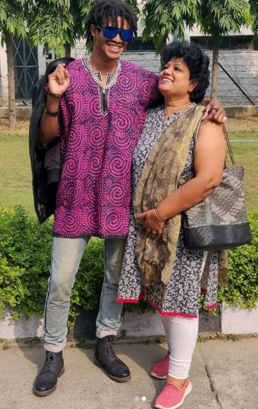 Michael Ajay with his mother