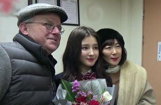 Nancy with her parents