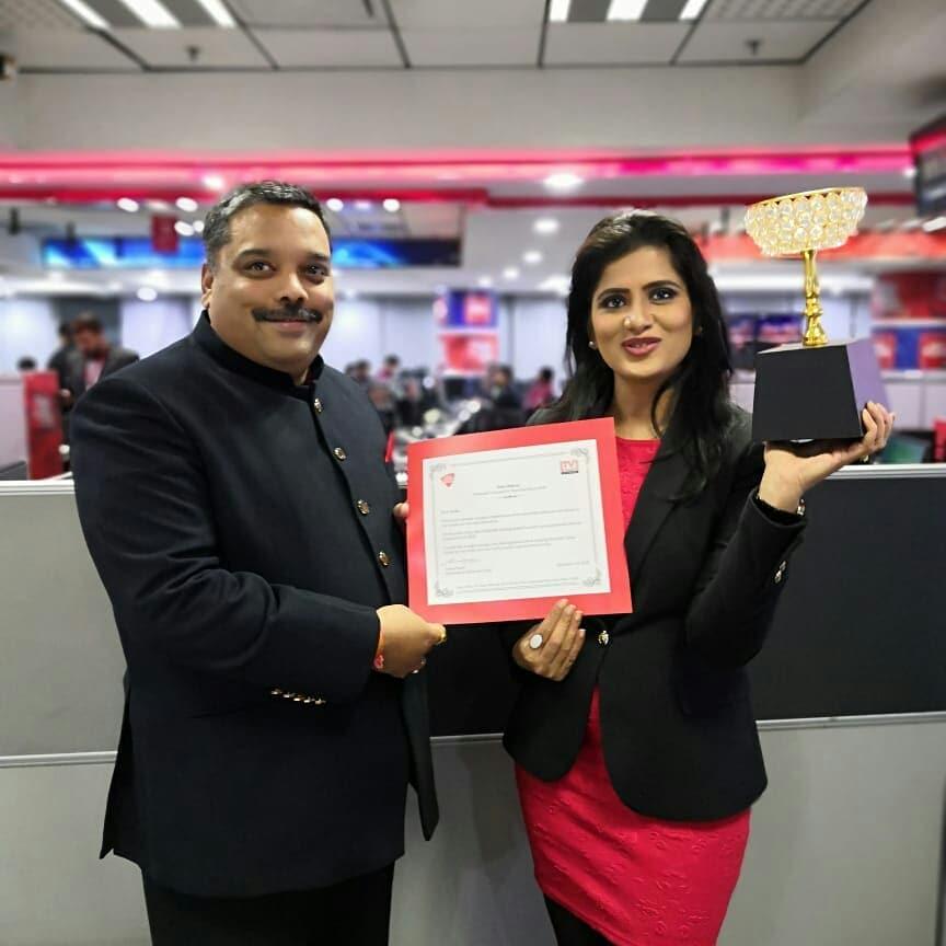 Neha Batham receiving an award