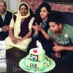 Suresh Raina with his parents and wife